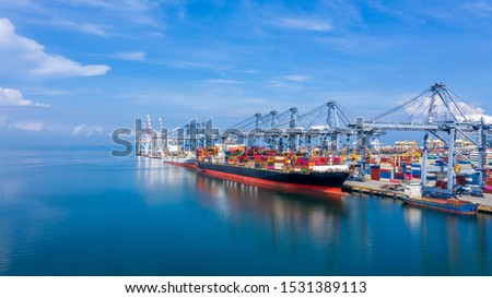 Container ship at industrial port in import export global business logistic and transportation, Container ship loading and unloading freight shipment, Aerial view container cargo boat freight ship.