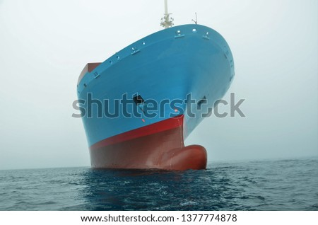Container ship at sea, view on the ships bow.