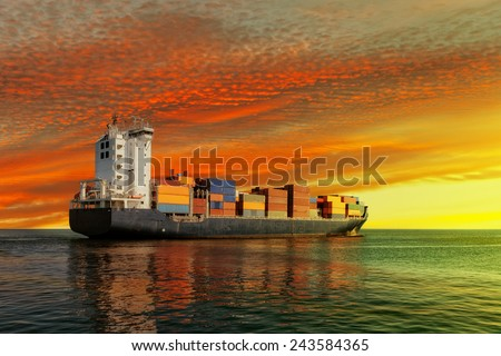 Container ship at sunset in the sea.