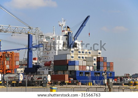 Container ship being loaded