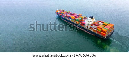 Container ship carrying container aerial view, Business import and export logistic and transportation of international by container ship in the open sea, with copy space.