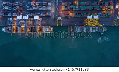 Container ship carrying container at night for import and export, business logistic and transportation by container ship in open sea, Aerial view container ship.