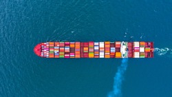 Container ship carrying container for global business freight shipping import export transportation logistic, Aerial view container ship arriving commercial port, Container loading cargo freight ship.