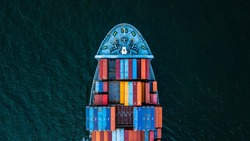Container ship carrying container for import and export, business logistic and transportation by container cargo ship in open sea, Aerial view container ship vessel.