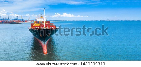 Container ship carrying container in import and export business commercial logistic and freight shipping transportation by container ship, Container loading cargo ship, Dubai, United Arab Emirates.