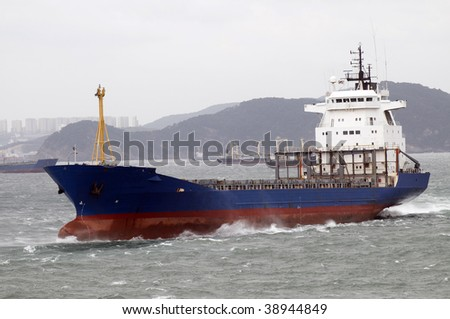Container ship designed for transporting of containers, sailing on the sea surface
