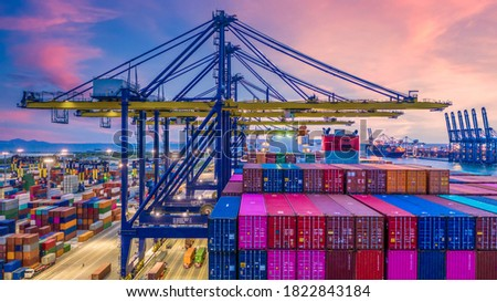 Container ship in deep sea port at night, Global business logistic import export freight shipping transportation oversea worldwide container ship, Container vessel loading cargo freight ship.