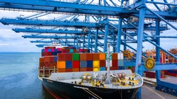 Container ship in export and import business and logistics, Container ship berthing port.