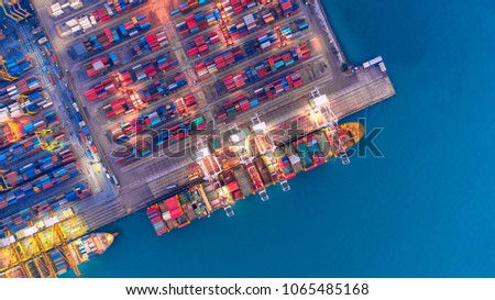 Container ship in export and import business and logistics. Shipping cargo to harbor by crane. Water transport International. Aerial view and top view. #1065485168