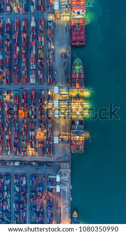 Container ship in export and import business and logistics. Shipping cargo to harbor by crane. Water transport International. Aerial view and top view. #1080350990