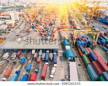 Container ship in export and import business and logistics. Shipping cargo to harbor by crane. Water transport International. Aerial view and top view #1085265155