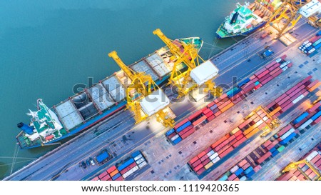 Container ship in export and import business and logistics. Shipping cargo to harbor by crane. Water transport International. Aerial view and top view. #1119420365