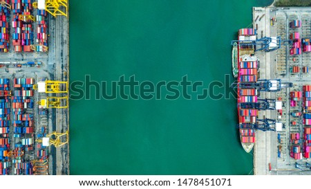 Container ship in export and import business and logistics. Shipping cargo to harbor by crane.