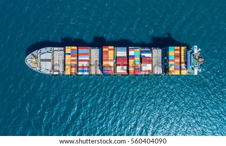 Container ship in export and import business and logistics. Shipping cargo to harbor by crane. Water transport International. Aerial view - Shutterstock ID 560404090