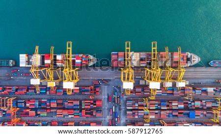 Container ship in export and import business and logistics. Shipping cargo to harbor by crane. Water transport International. Aerial view #587912765