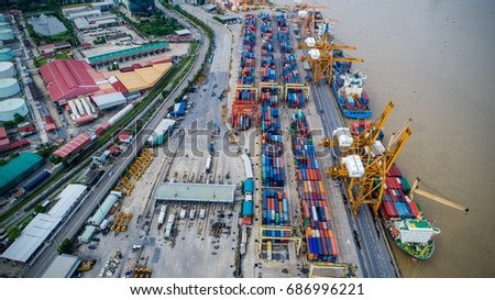 Container ship in import export and business logistic, By crane, Trade Port, Shipping cargo to harbor, Aerial view from drone, International transportation, Business logistics concept #686996221