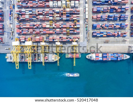 container ship in import export and business logistic.By crane , Trade Port , Shipping.Tugboat assisting cargo to harbor.Aerial view.Water transport.International.Shell Marine.