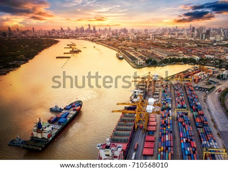 Container ship in import export and business logistics, By crane, Trade Port, Shipping cargo to harbor, Aerial view from drone, International transportation, Business logistics concept