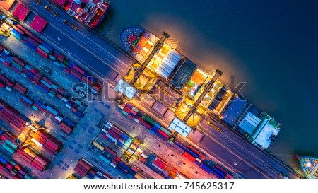 Container ship in import export and business logistics, By crane, Trade Port, Shipping cargo to harbor, Aerial view from drone, International transportation, Business logistics concept #745625317