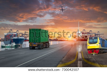 container ship in import,export port against beautiful sunset light of loading ship yard use for freight and cargo shipping vessel transport #730042507