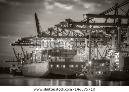 Container ship in the harbor of Hamburg. Black and White.