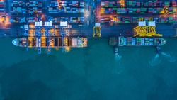 Container ship loading and unloading in deep sea port, Aerial view business commercial trading logistic import and export freight transportation, Container loading cargo freight ship maritime at night