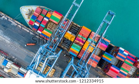 Container ship loading at port with crane, container ship carrying container import and export business logistic and transportation, Aerial top view. #1212334915