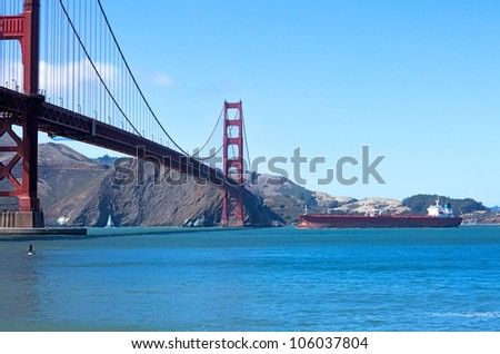 Container ship nearing Golden Gate Bridge.