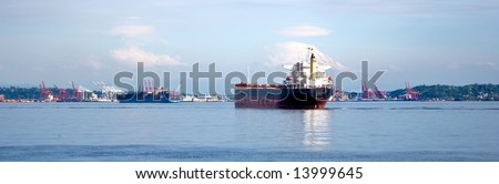 Container ship on Puget Sound under Mt Rainier