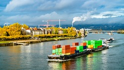 Container ship on the Rhine River in Mainz - Rhineland-Palatinate, Germany