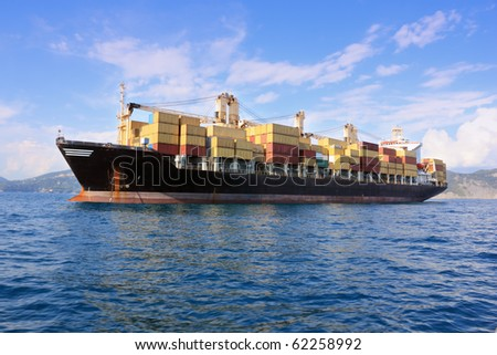 container ship outside harbor - stock photo