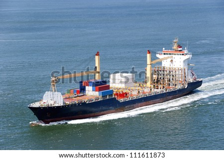 Container Ship travelling to a harbor far away where it will unload its fright