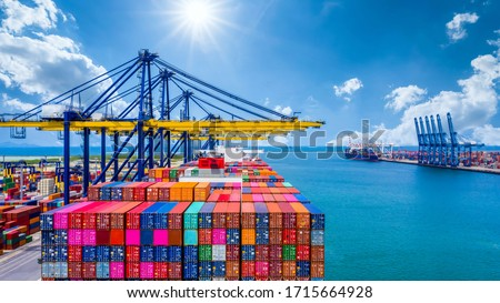 Container ship unloading in deep sea port, Global industry business logistic import export freight shipping transportation oversea worldwide by container ship, Container vessel loading cargo freight.