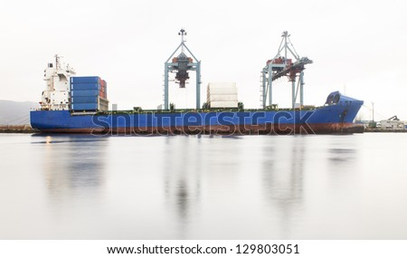 container ship whit cranes on port