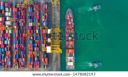 Container ship working at industrial port, Business import and export logistic and transportation of International by container ship in the open sea, Aerial view container ship loading and unloading.