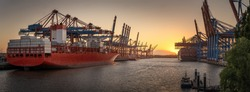 Container ships in the port of Hamburg at sunset