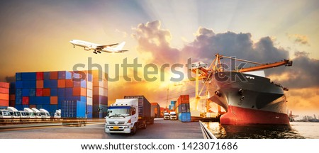 Container truck in ship port for business Logistics and transportation of Container Cargo ship and Cargo plane with working crane bridge in shipyard, logistic import export and transport industry