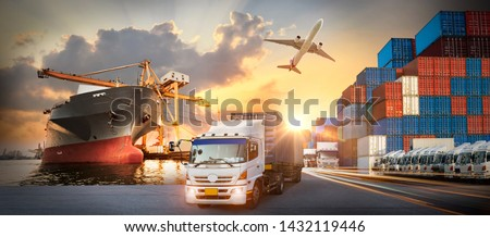 Container truck in ship port for business Logistics and transportation of Container Cargo ship and Cargo plane with working crane bridge in shipyard at sunrise, logistic import export and transport  #1432119446