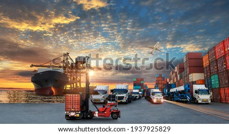 Container truck in ship port for business Logistics and transportation of Container Cargo ship and Cargo plane with working crane bridge in shipyard at sunrise, logistic import export concept Photo stock ©