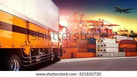 container truck in shipping port ,container dock and freight cargo plane flying above use for transportation and logistic industry