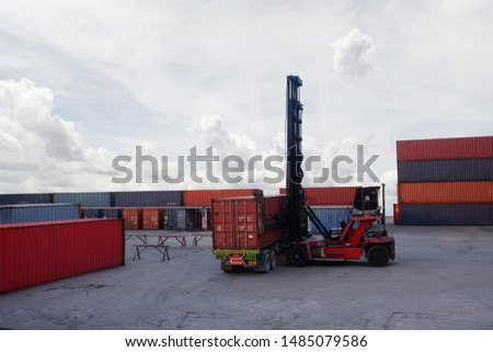Container truck loading containers from trucks