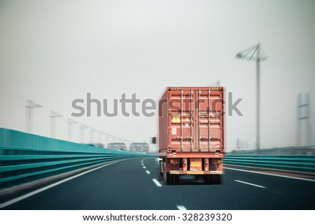 container truck on the bridge with motion blur , modern logistics background #328239320