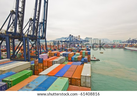 container vessel and a small tug boat - mooring operations in Hong Kong