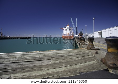 Container vessel berthed in New Plymouth container terminal. New Zealand, North Island.
