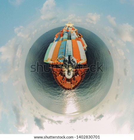 Container vessel in the ocean tiny planet #1402830701