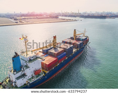 container vessel ship under proceeding to the main entrance channel due of the port in aerial view