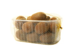 Container with ripe kiwi isolated on white background