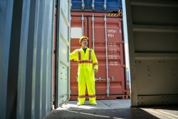 Container worker working at container cargo freight ship,Business logistic concept, Import and export concept.
