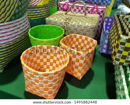 Containers fabricated from nylon strapping
