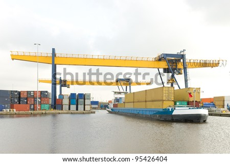 containers for local transport on a small ship - stock photo